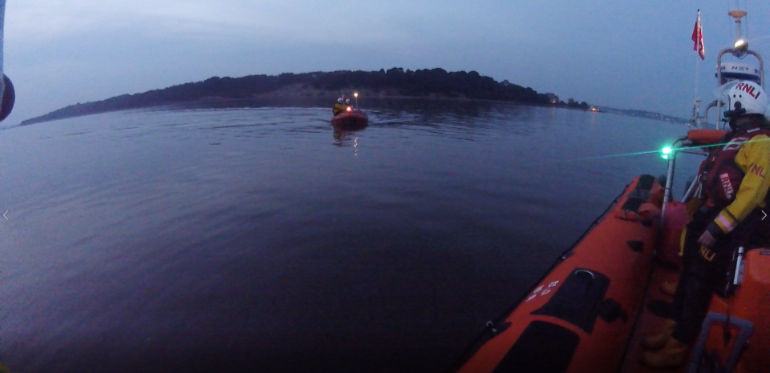 Both Poole lifeboats work together to effect rescue in shallow water